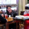 Robot Waiter Serves In Chinese Restaurant