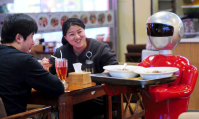 Robot Waiter Serves In Chinese Restaurant