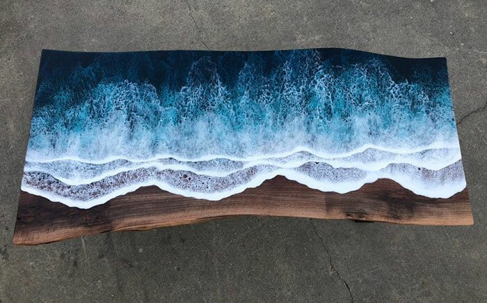 table covered with waves of resin